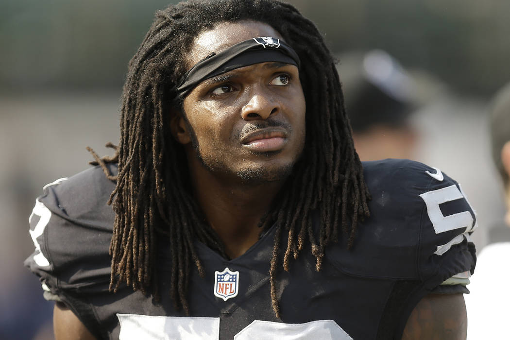 Former Oakland Raiders outside linebacker Neiron Ball (58) stands on the sideline during the se ...