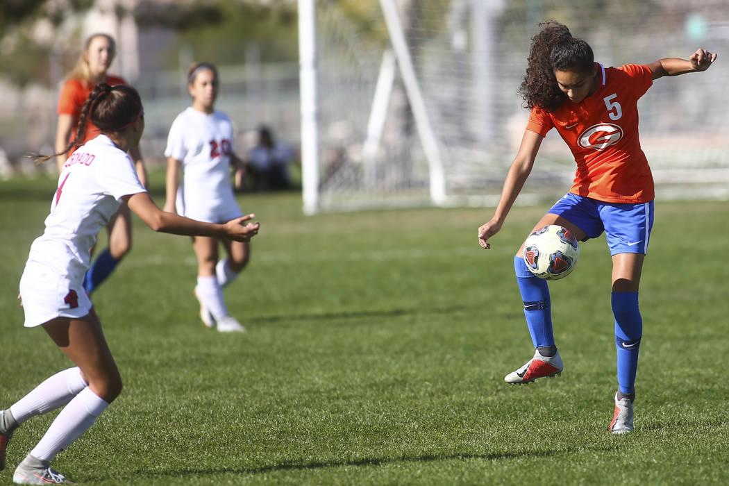 Bishop Gorman's Samantha Nieves (5) kicks the ball past Coronado during the Desert Region girls ...