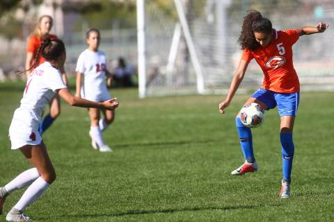 Bishop Gorman's Samantha Nieves (5) kicks the ball past Coronado during the Desert Region girls ...