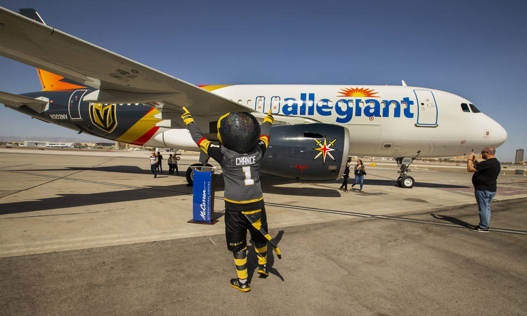 Chance the Gila monster salutes the new plane as Allegiant unveils a new Golden Knights-themed ...