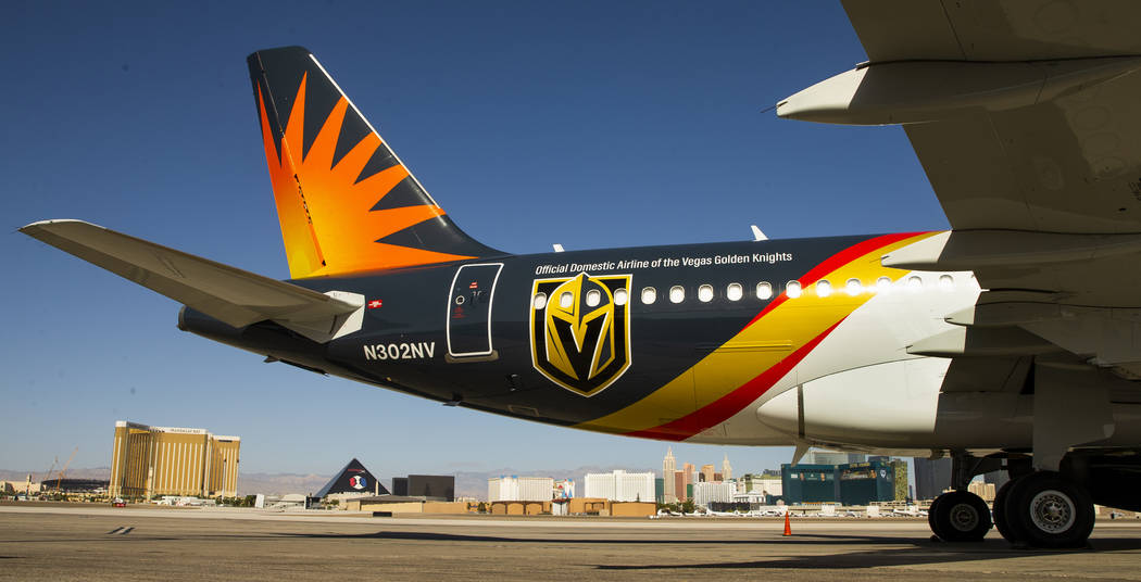 Team markings adorn the plane as Allegiant unveils a new Golden Knights-themed plane at McCarra ...