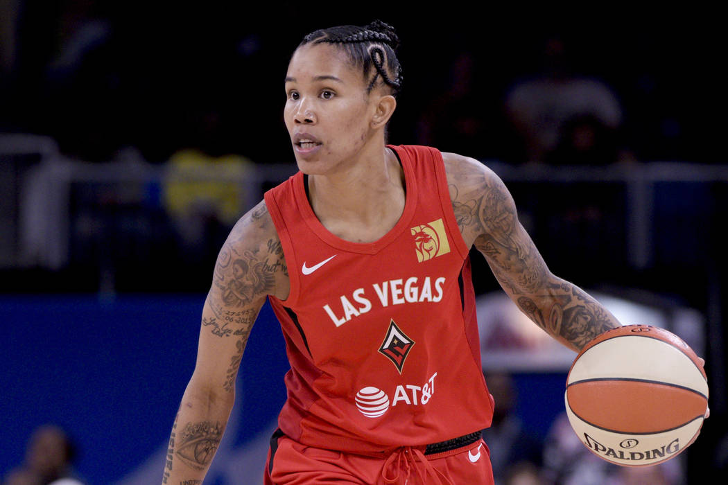 Las Vegas Aces' Tamera Young advances ball during the first half a WNBA basketball game against ...