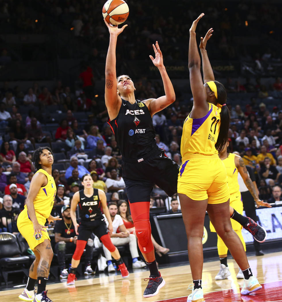 Las Vegas Aces' Liz Cambage shoots against Los Angeles Sparks' Kalani Brown (21) during the fir ...