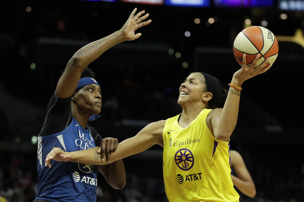 Minnesota Lynx center Sylvia Fowles, left, fouls Los Angeles Sparks forward Candace Parker duri ...