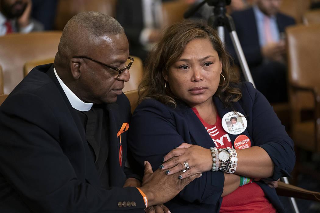 Rev. Jackie Jackson, left, an anti-violence advocate from Cincinnati, and gun violence survivor ...