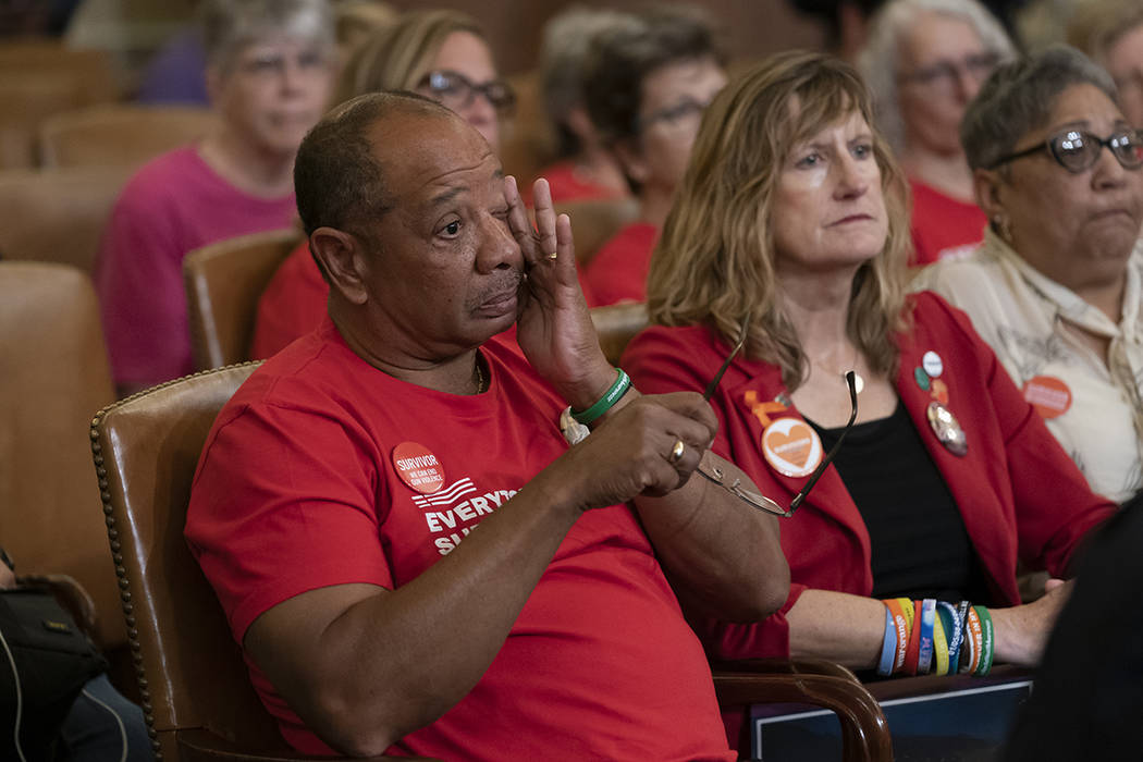Activists and survivors of gun violence listen as House Speaker Nancy Pelosi, D-Calif., and Rep ...