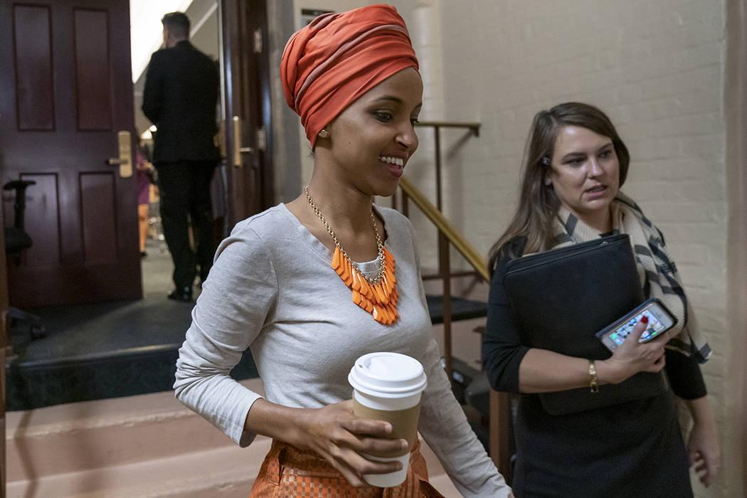 Rep. Ilhan Omar, D-Minn., departs a meeting of the House Democratic Caucus as Congress returns ...