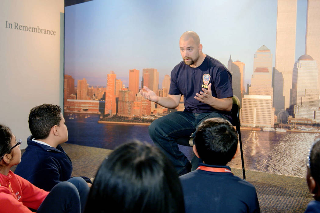 This image released by HBO shows a New York City Fireman speaking to children in a scene from t ...