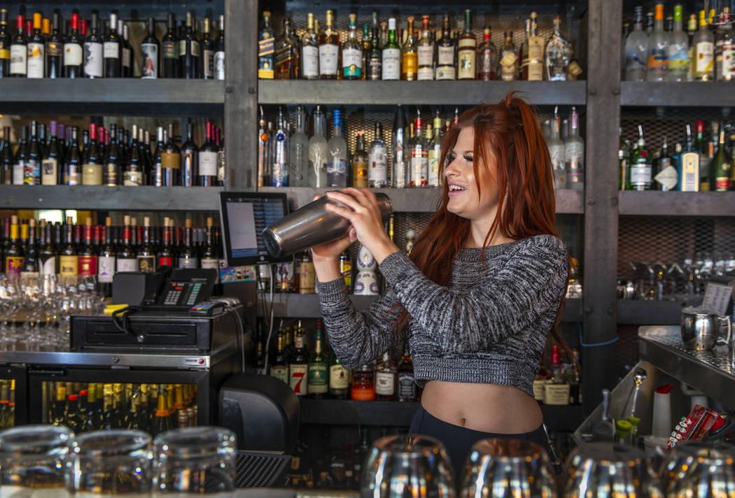 Bartender Alexandria Spina prepares a cocktail at Grape Street Café, Wine Bar & Cellar in Down ...