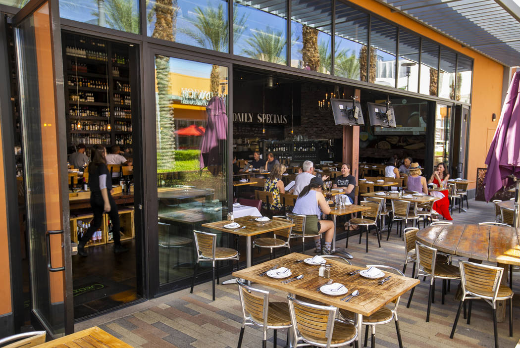 Customers enjoy lunch on the deck at Grape Street Café, Wine Bar & Cellar in Downtown Summerli ...