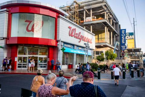 People walk by the Walgreens on the Las Vegas Strip on Tuesday, Sept. 10, 2019, in Las Vegas. T ...