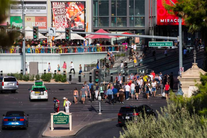 Visitors crowd the Las Vegas Strip outside of the Miracle Mile Shops as people arrive for the L ...