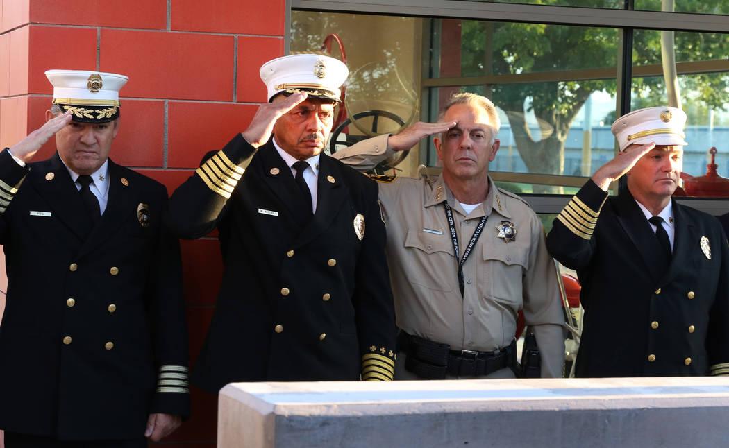 City of Las Vegas Fire Chief William McDonald, second left, and Clark County Sheriff Joseph Lom ...