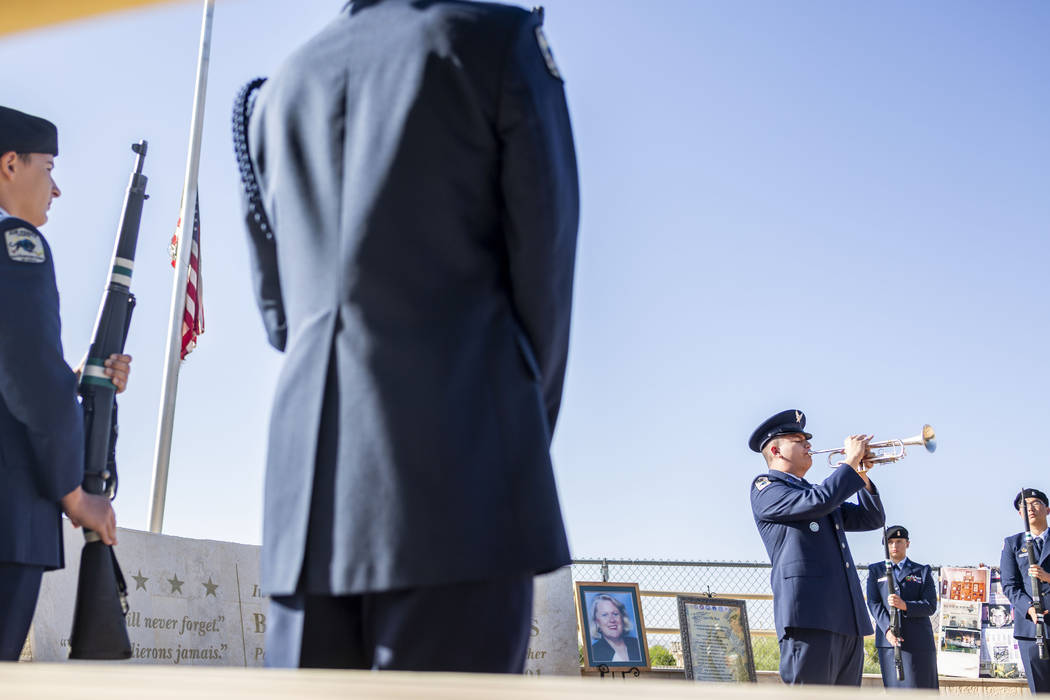 Cadet 1st Lt. Daniel Deleon, 17, plays while a flag is lowered during Palo Verde High School's ...