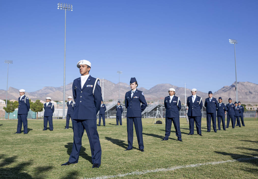 Palo Verde High School students in the Air Force JROTC stand in memory of the school's foreign ...