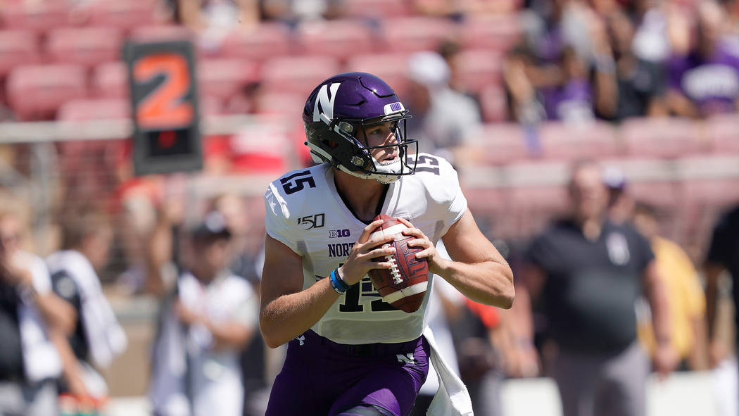 Northwestern quarterback Hunter Johnson (15) in action against Stanford in the first half durin ...