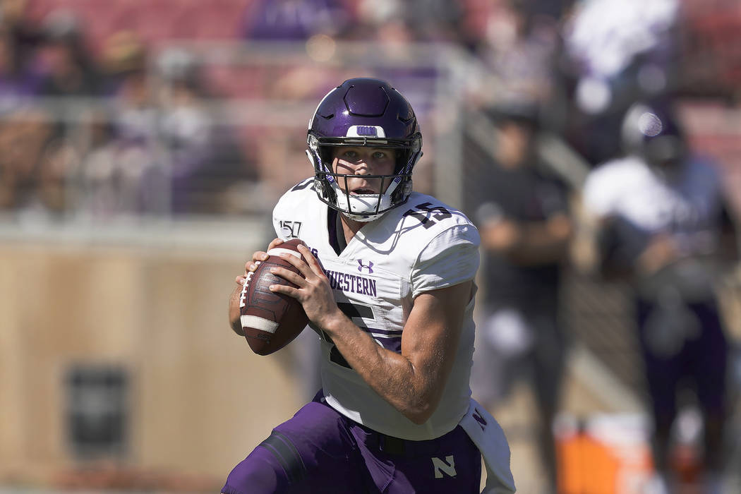 Northwestern quarterback Hunter Johnson (15) in action against Stanford during the second half ...