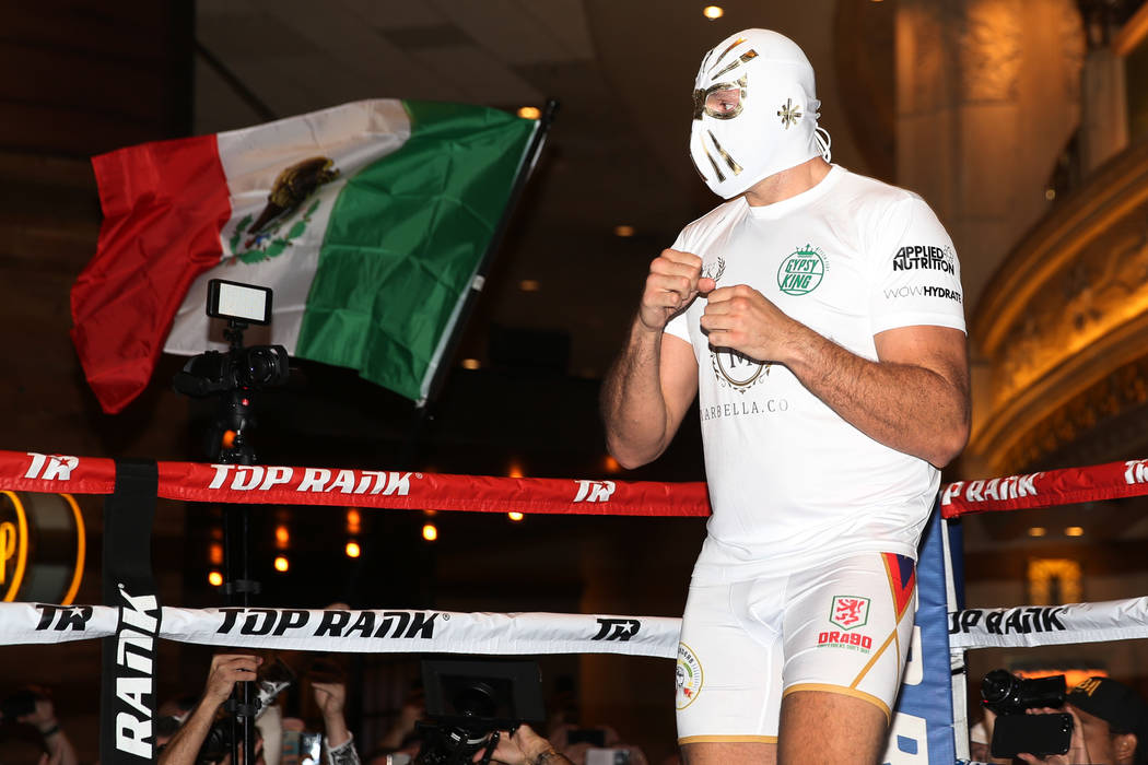 Heavyweight fighter Tyson Fury takes the ring wearing a Mexican wrestling mask during an open w ...