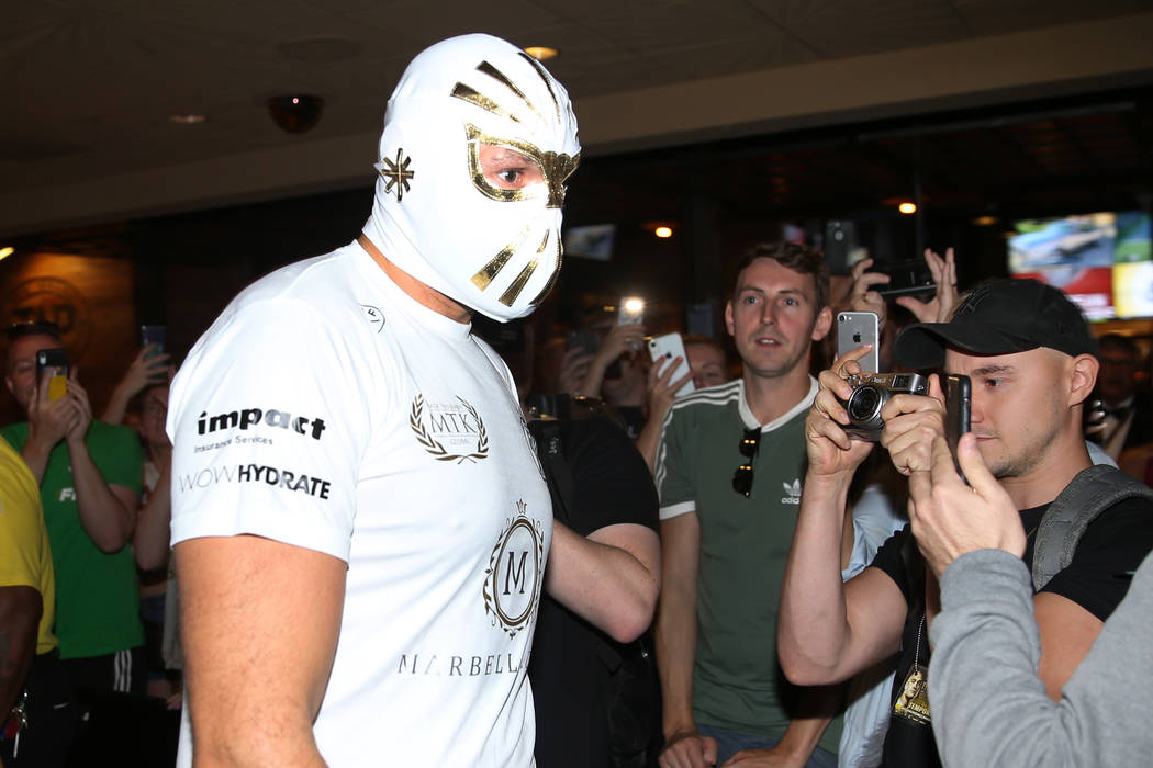 Heavyweight fighter Tyson Fury makes his way to the ring wearing a Mexican wrestling mask for a ...