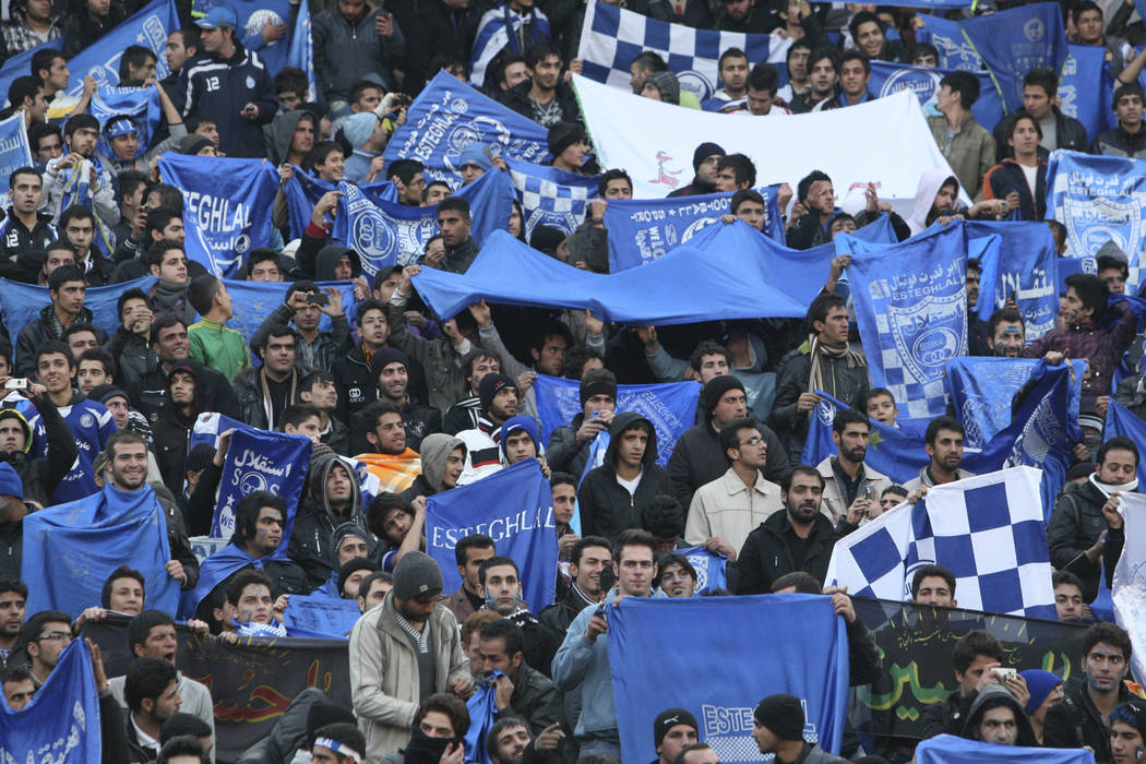 FILE - In this Dec. 9, 2011 file photo, supporters of Iranian soccer team Esteghlal, hold flag ...