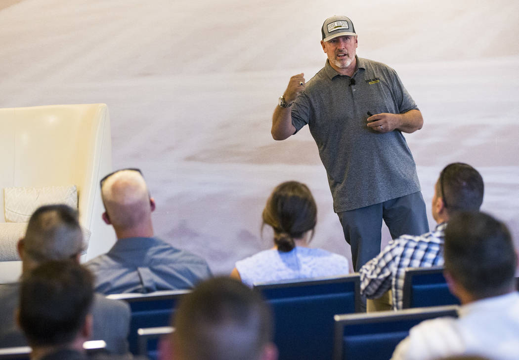 Retired Master Sgt. Scott Neill, who co-founded the American Freedom Distillery, speaks during ...