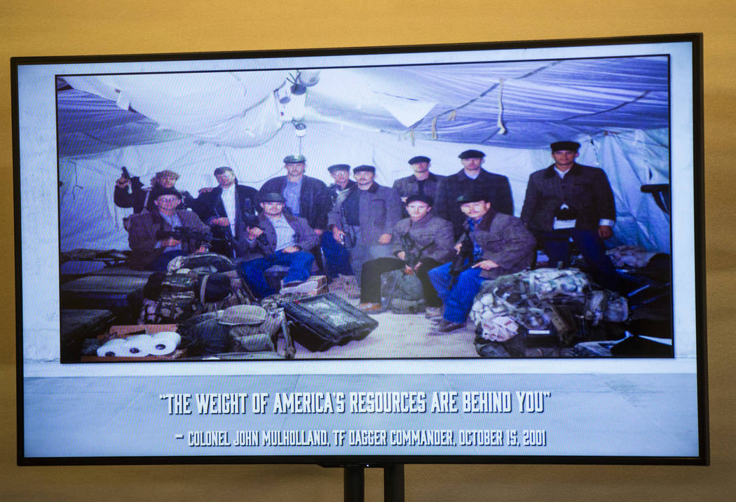 """A group photo of the """"Horse Soldiers"""" dressed in local wear as pictured while they we ..."""