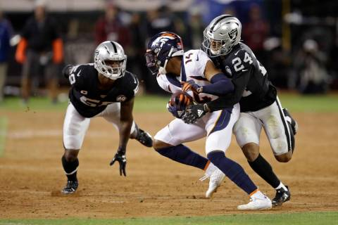 Denver Broncos wide receiver Courtland Sutton is brought down by Oakland Raiders defensive back ...