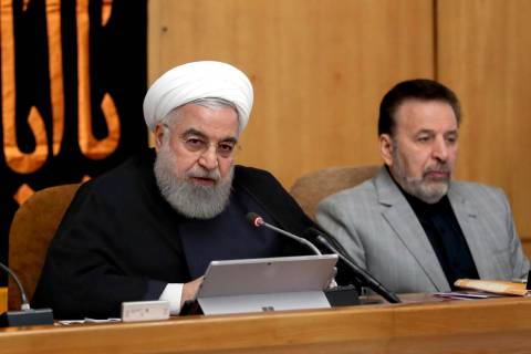 In this photo released by the office of the Iranian Presidency, President Hassan Rouhani speaks ...