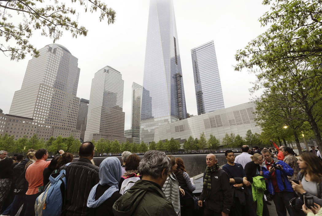 FILE- In this May 15, 2015 file photo, visitors gather near the pools at the 9/11 Memorial in N ...