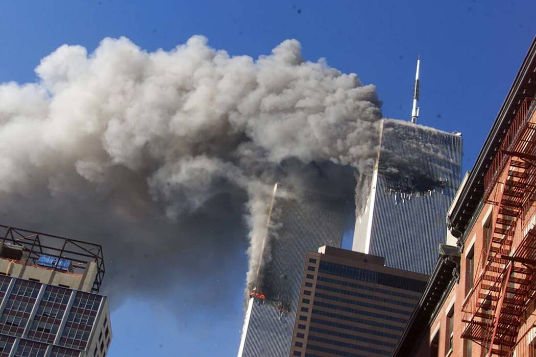 FILE - In this Sept. 11, 2001, file photo, smoke rises from the burning twin towers of the Worl ...