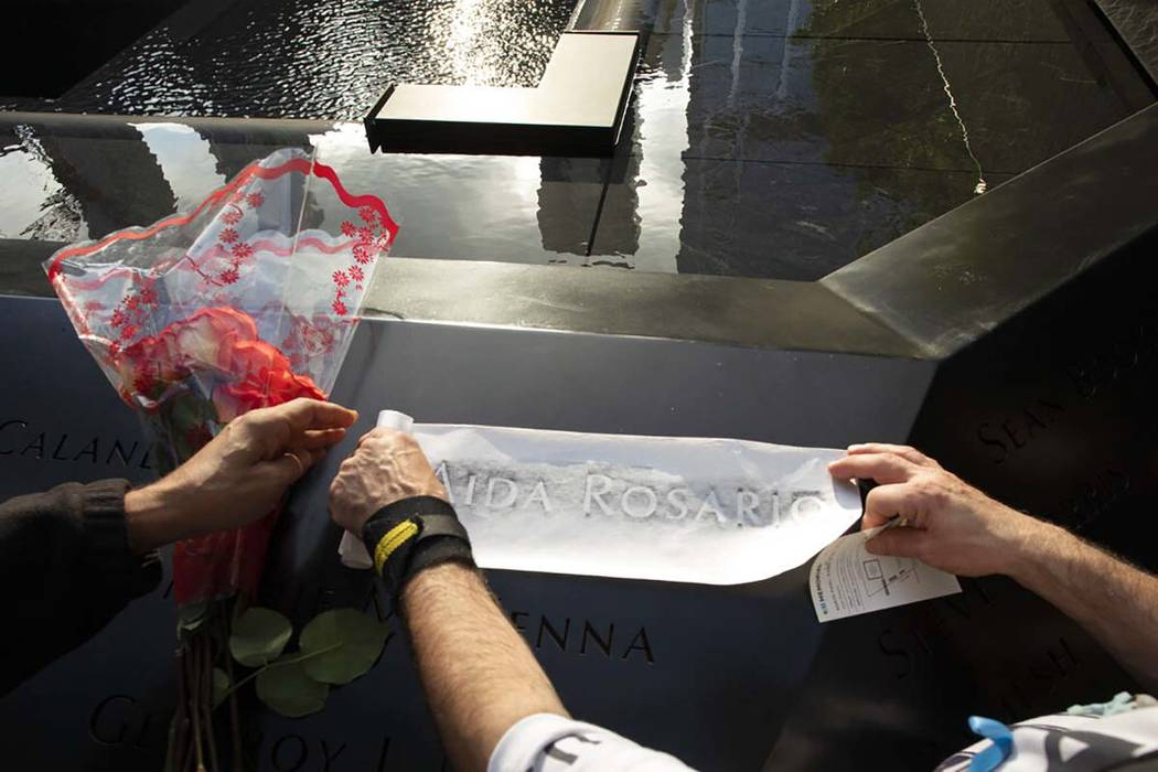 Louis Gonzalez makes a rubbing of his sister's name at the National September 11 Memorial, Wedn ...