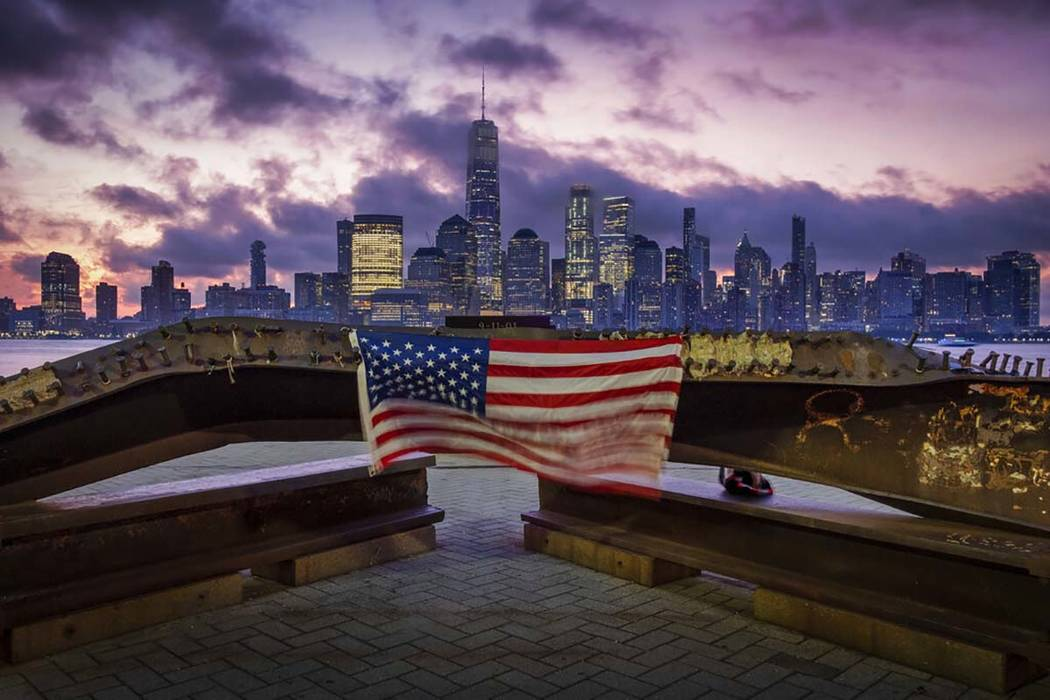 A U.S. flag hanging from a steel girder, damaged in the Sept. 11, 2001 attacks on the World Tra ...