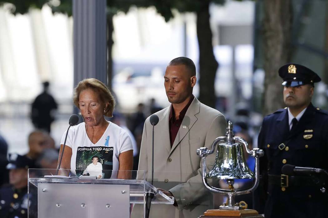 The names are read of victims of the Sept. 11 attacks during a ceremony marking the 18th annive ...