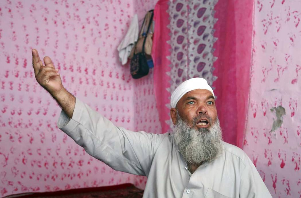 In this Tuesday, Sept. 10, 2019, photo, Hayat Khan, 54, speaks during an interview with The Ass ...