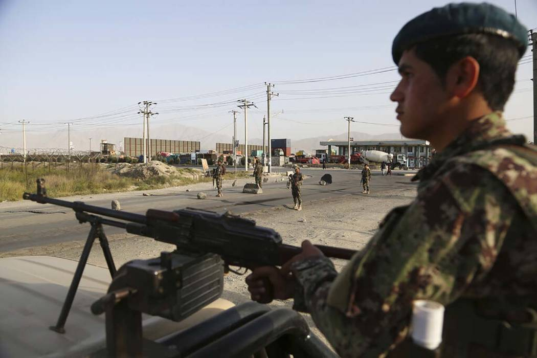 In this Tuesday, Sept. 10, 2019, photo, Afghan National Army soldiers stand guard at a checkpoi ...