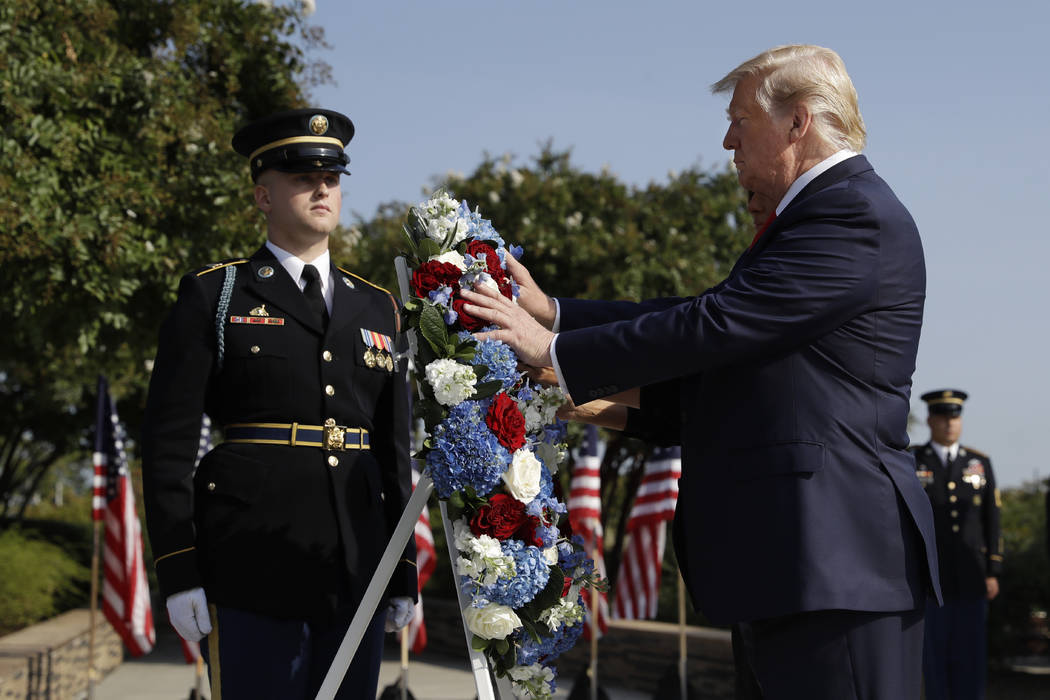 President Donald Trump and first lady Melania Trump place a wreath and will participate in a m ...