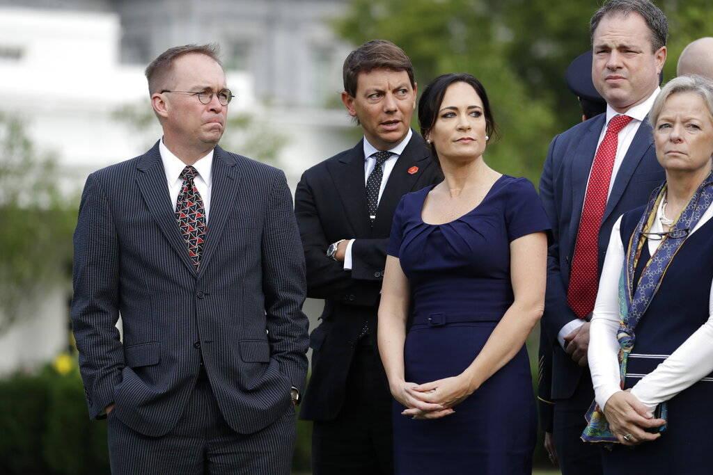 Acting White House Chief of Staff Mick Mulvaney, left, White House deputy press secretary Hogan ...