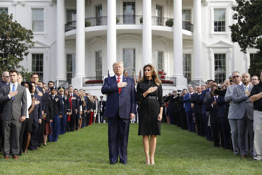 President Donald Trump and first lady Melania Trump participate in a moment of silence honoring ...