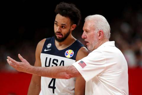 United States' coach Gregg Popovich, right instructs United States' Derrick White during a matc ...