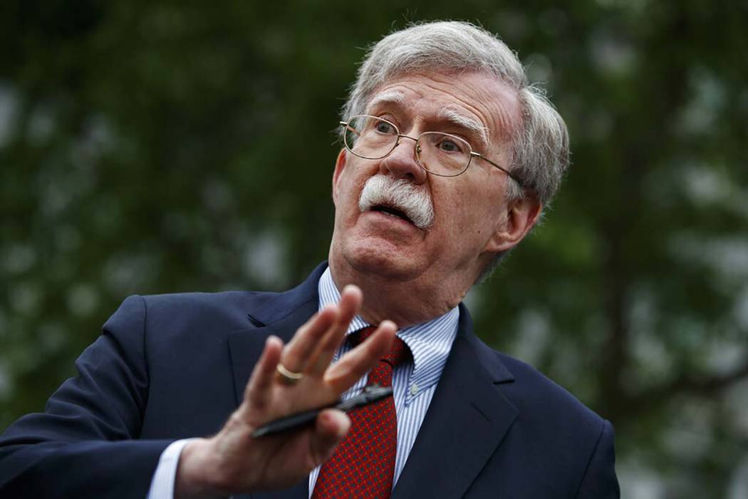 In a May 1, 2019, file photo, National security adviser John Bolton talks to reporters outside ...