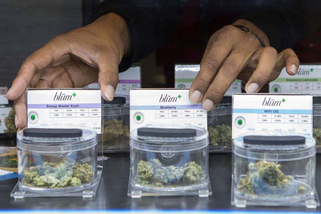 Budtender Kyle Ransom adjusts a display at BLÜM Las Vegas Medical Marijuana Dispensary on Wedn ...
