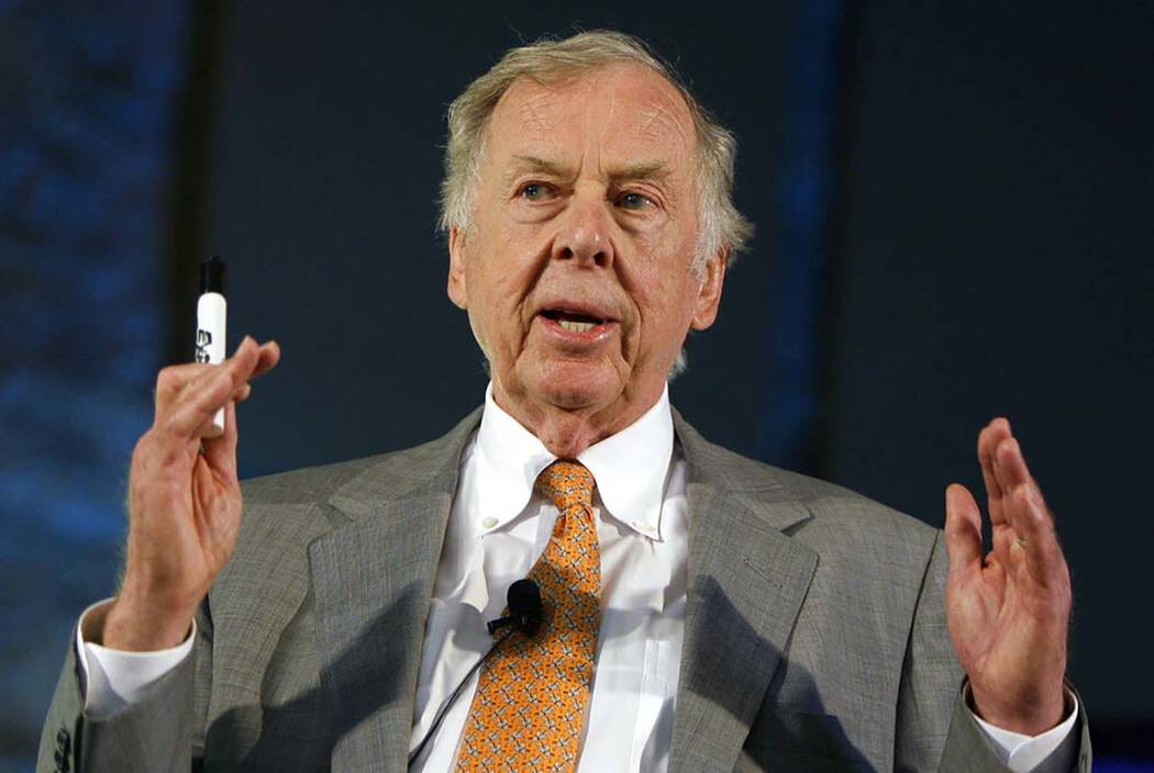 In a July 30, 2008, file photo, oil and gas developer T. Boone Pickens addresses a town hall me ...