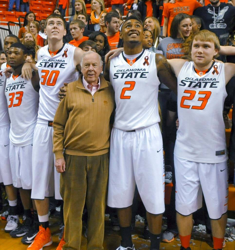 In a March 2, 2013, file photo, oil tycoon and Oklahoma State supporter T. Boone Pickens, cente ...