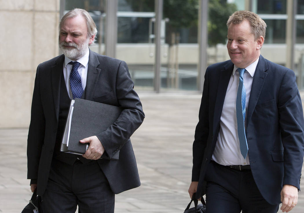 United Kingdom's Brexit advisor David Frost, right, and British Ambassador to the EU Tim Barrow ...