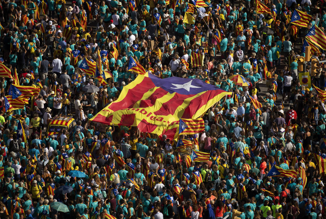 Protesters hold esteladas or independence flags as they take part in a demonstration during the ...