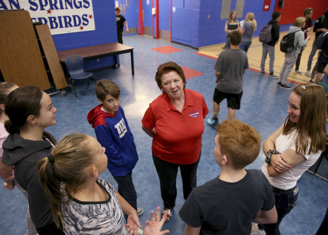 Dottie Frank, an administrative school secretary at Indian Springs School, visits with students ...