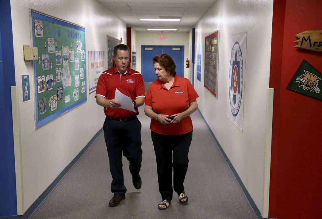 Dottie Frank, an administrative school secretary at Indian Springs School, talks to Principal D ...