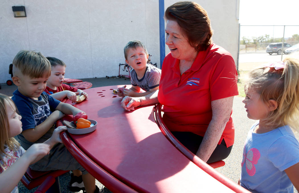 Dottie Frank, an administrative school secretary at Indian Springs School, visits with pre-kind ...