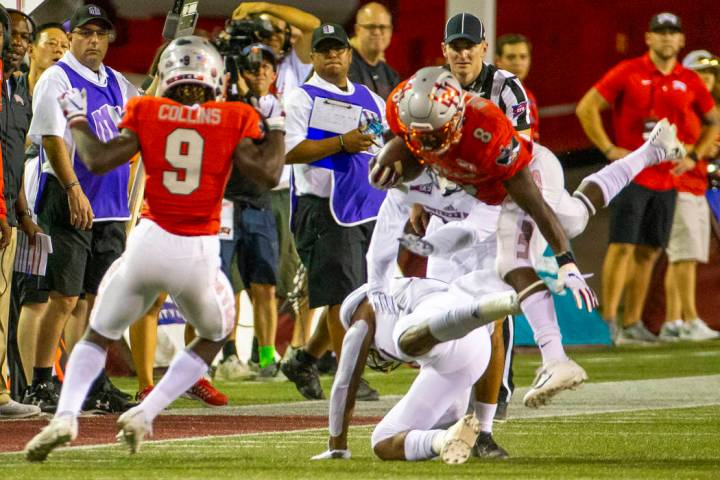 UNLV Rebels running back Charles Williams (8) is upended on a run over Southern Utah in the fir ...