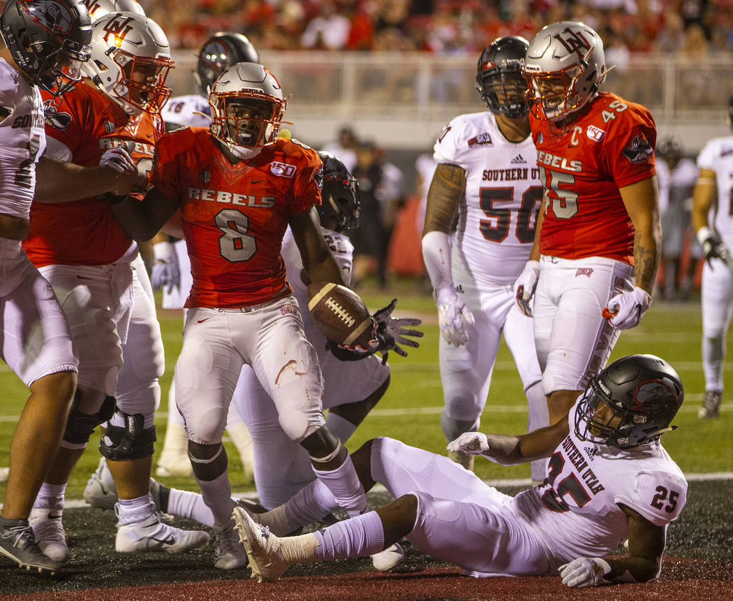 UNLV Rebels running back Charles Williams (8) celebrates a touchdown over Southern Utah at Sam ...